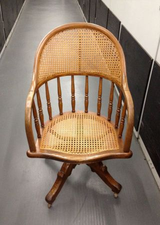 Oak Swivel Desk Chair With Cane Seat And Back,  Iron Base photo