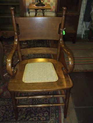 Antique Oak Chair Bentwood Arms Cane Seat Refinished. photo
