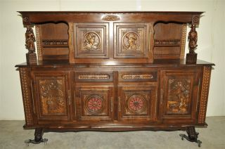 French Breton Cabinet In Oak With Carved Statues photo