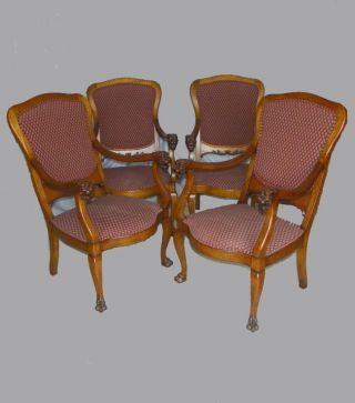 Antique Set Of Four Upholstered Chairs With Lion Heads photo
