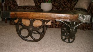 Vintage Industrial Aged Wood And Cast Iron Railroad Wheel Cart Coffee Table photo