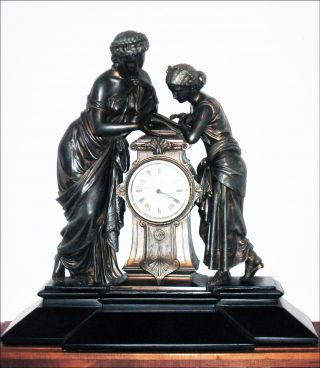 Antique Figural Mantle Clock photo