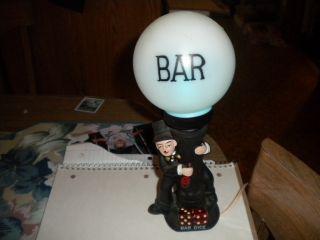 Vintage Enesco Ceramic Drunken Man On Post Dice Bar Lamp photo