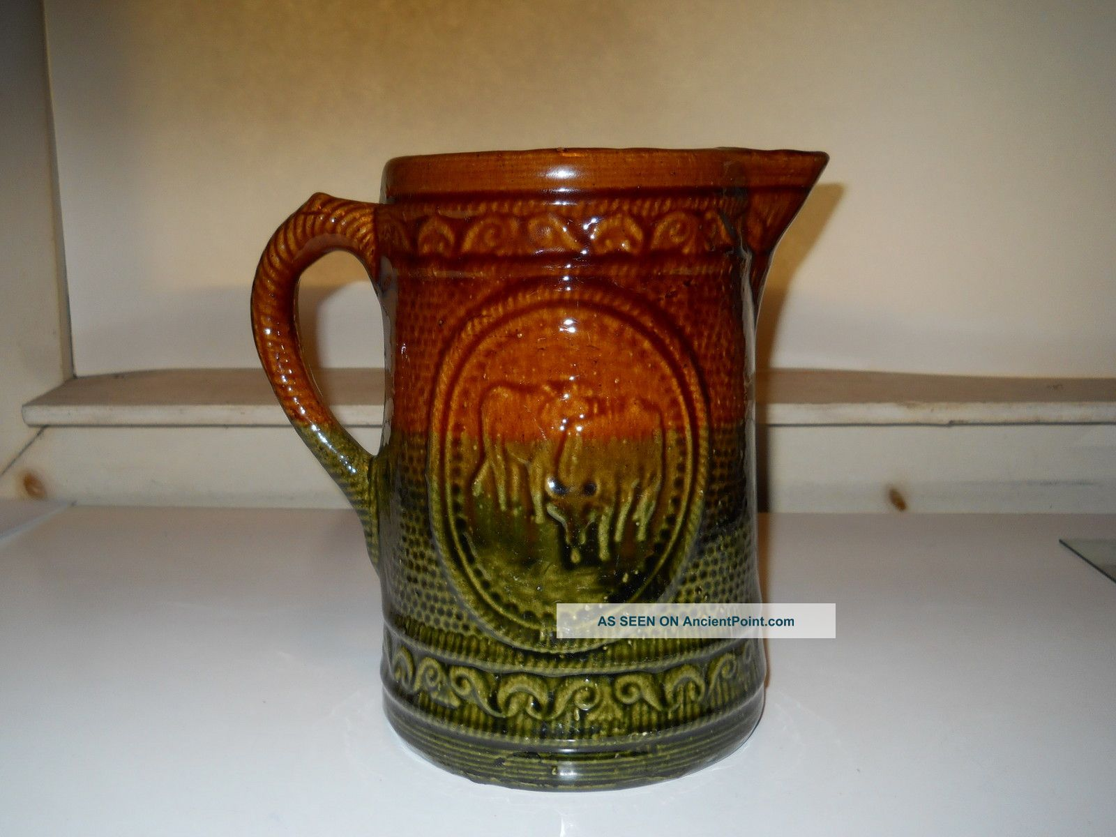 Antique Stoneware Pitcher W/ Emb.  Cows Design Brown/green Glaze Rare Mint Cond. Pitchers photo