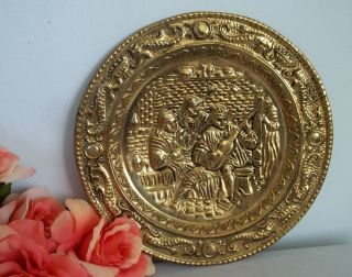 Vintage Stamped Brass Plate With Musician photo