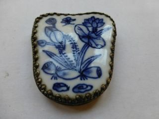 Lovely Blue And White Pottery In Silver Alpaca Frame photo
