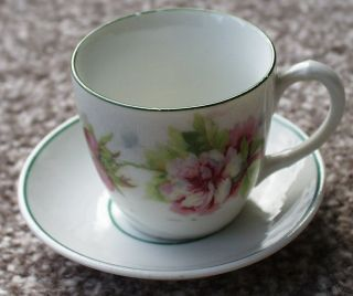 Miniature Antique Cup And Saucer With Rose Design photo