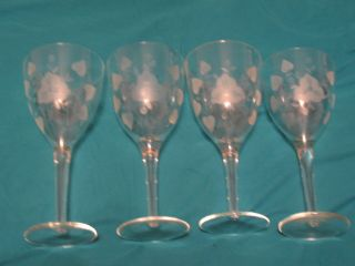Four Clear Long Stem Glasses With A Floral Design & Heart Shaped Leafs photo