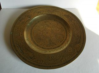Antique Chinese Brass Plate With Engraved Dragon Chasing Pearl Design photo