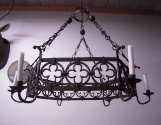 A Wrought Iron Gothic Art Candle Burning Chandelier photo