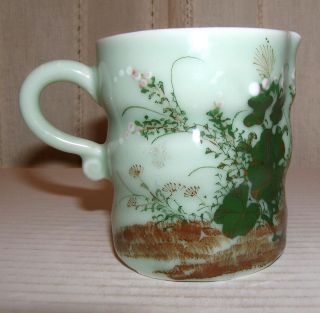 Lovely Old Studio Arts Handcrafted Celadon Prunus Blossoms Pitcher,  3.  5
