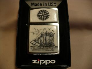Scrimshaw Cow Bone Wide Zippo Lighter Schooner - Compass Rose photo