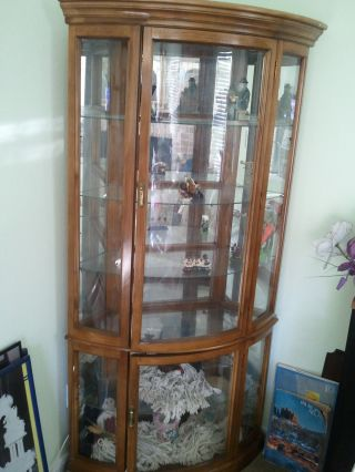 Solid Bowed Glass Corner Curio Cabinet photo