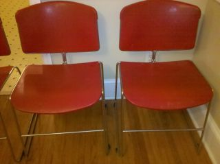 Four (4) Red Steelcase Max Stacker Stacking Chairs,  Stainless Steel,  Eames Era photo