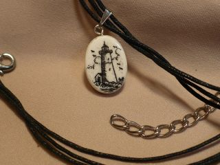 Scrimshaw Cow Bone Pendant Lighthouse photo