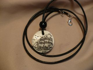 Scrimshaw Cow Bone Pendant Side Ship photo