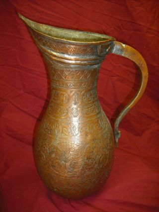 Unusual Islamic Copper Pitcher photo
