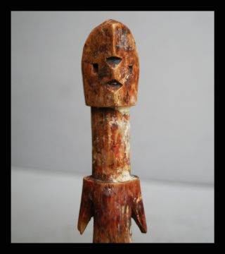 An Encrusted Ancestor Figure From The Adan Tribe Of Ghana photo