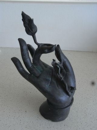 Hand Holding Lotus Flower Bronze Sculpture photo