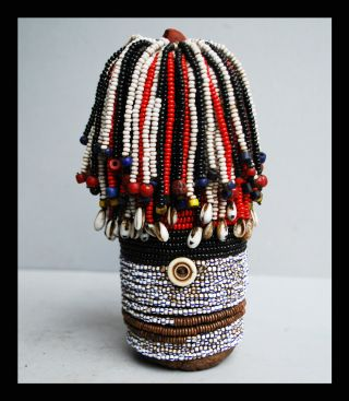 A Clay Doll Adorned With Glass Beads From Turkana Tribe Kenya photo