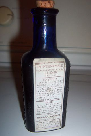 Reed & Carnrick Peptenzyme Elixir Cobalt Medicine Bottle With Label photo