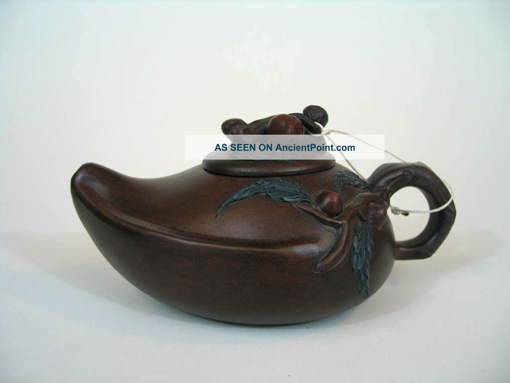 A Chinese Yixing Teapot In The Peach Shape With Maker ' S Mark Teapots photo