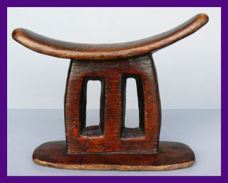 Unusual Shaped Glossy Headrest From Ethiopia photo