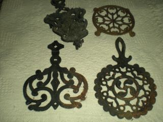 3 Cast Iron Trivets - 1 Aluminum Trivet J.  Z.  H.  John Wright photo