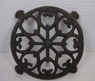 Vintage Round Cast Iron Trivet With Claw Feet photo