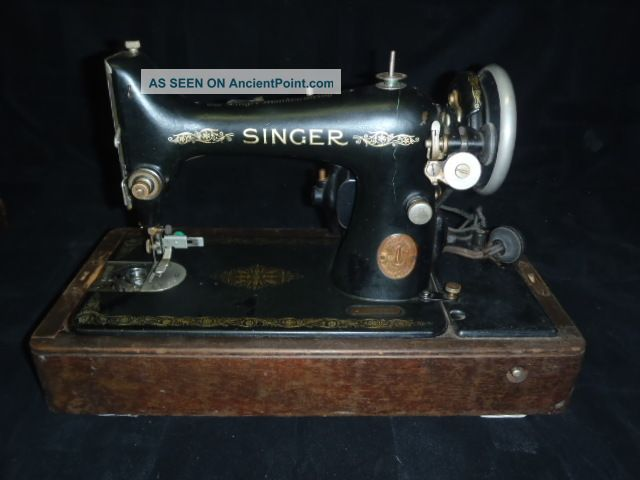Singer Sewing Machine And Wood Case Sewing Machines photo