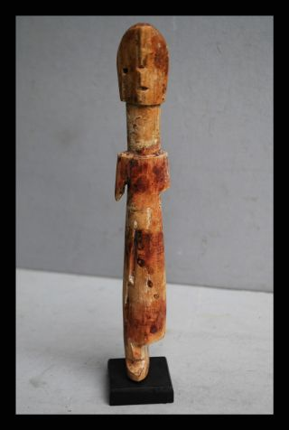 A Striped Red+ White Ancestor Figure From The Adan Tribe Of Ghana photo