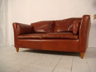 Stylish Shaped Leather Vintage Sofa. photo