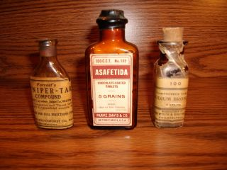 Three Medicene Bottles,  One Never Opened. photo