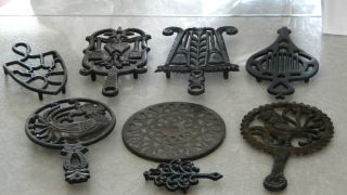 8 Antique / Vintage Cast Iron Trivets.  Leonard,  Emic,  Wilton,  Vcm photo