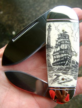 Nautical Scrimshaw,  Ship,  Lighthouse,  Dolphin,  Folding Knife/knives photo