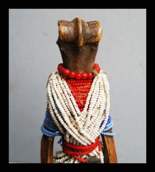 A Bone Doll Adorned With Glass Beads From Turkana Tribe Kenya photo