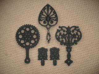 5 Antique Cast Iron Trivets photo