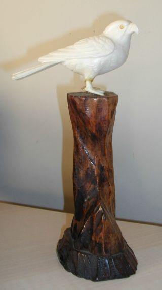 An Antique Oriental Finely Carved Faux Ivory Figure Of A Bird On Wooden Stand photo