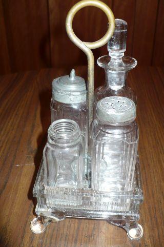 Antique Vintage Glass Caster Cruet Set With 4 Bottles Shakers & Metal Handle photo