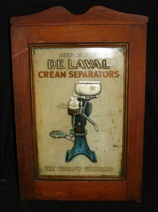 De Laval Cream Separator Antique Cabinet - Tin Lithograph & Oak - General Store photo