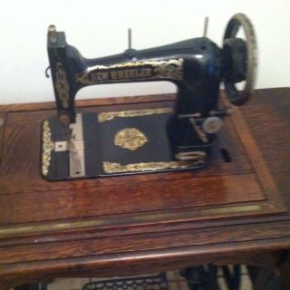 Antique New Wheeler Sewing Machine photo