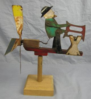 Antique Folk Art Metal Whirligig Man Sawing Log photo