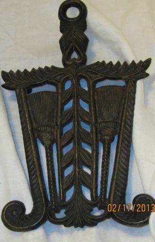 Antq Cast Iron Footed Sad Iron Trivet Tassel & Grain Pattern By Wilton
