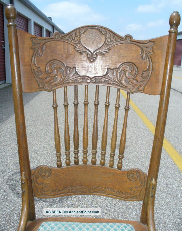 - Antique Pressed Back Oak Rocking Chair