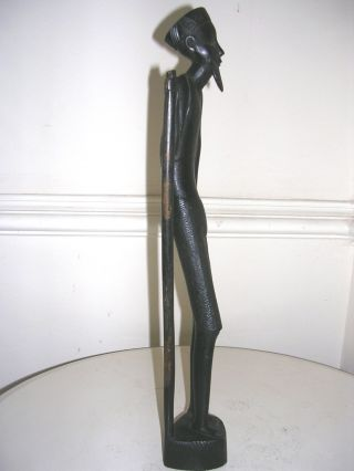A Carved Male African Tribal Figure. photo