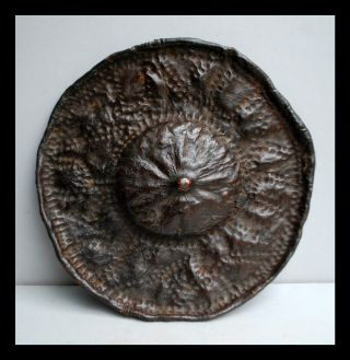 A Textural Leather Shield From Jinka Tribe Of Ethiopia photo