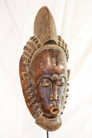 A Beautifully Carved Baule Portrait Mask From Ivory Coast photo