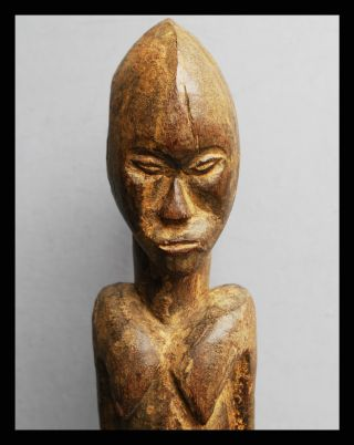 A Tall And Weathered Thil Figure,  From The Lobi Tribe Of Burkina Faso photo