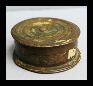A Patina Rich Rare Circular 18thc Akan Gold Dust Container photo