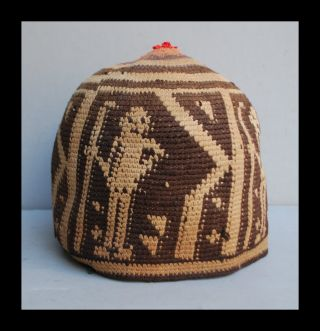 A Rare Secret Society Hat With Human Figures From Cameroon photo